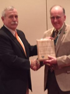 Dr. Jim Finley accepting the Family Forest Education Award for Pennsylvania State University